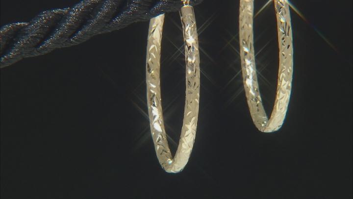 10K Yellow Gold 19MM Polished & Diamond Cut Oval Tube Hoop Earrings