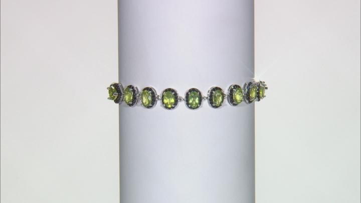 Green peridot rhodium over silver bracelet 5.76ctw