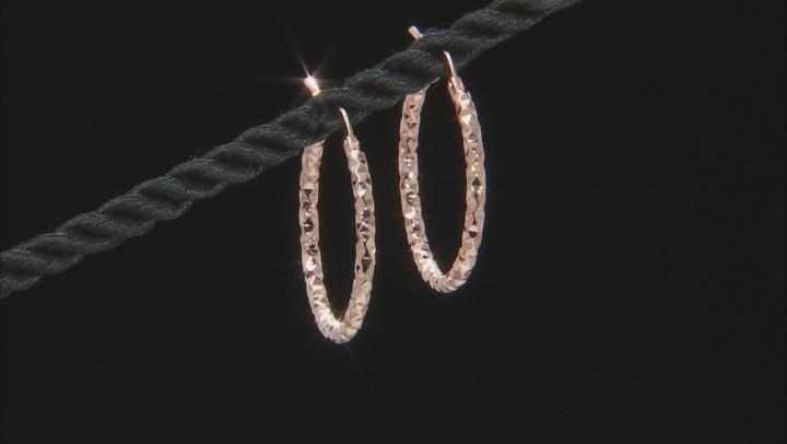 18k rose gold over bronze hoop earrings.