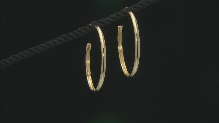 18k yellow gold over bronze open hoop earrings.
