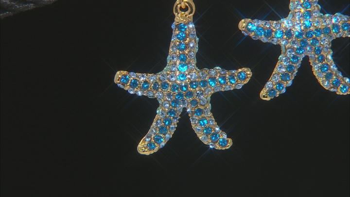 Blue crystal gold tone starfish earrings