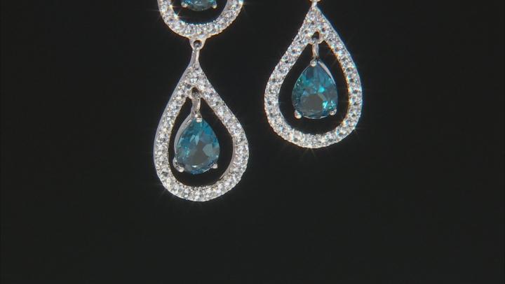 Blue topaz rhodium over silver dangle earrings 6.82ctw