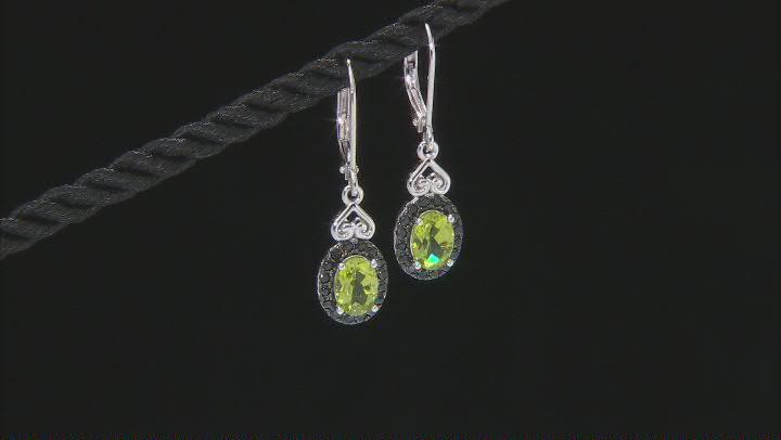 Green Peridot Rhodium Over Sterling Silver Dangle Earrings. 1.85ctw