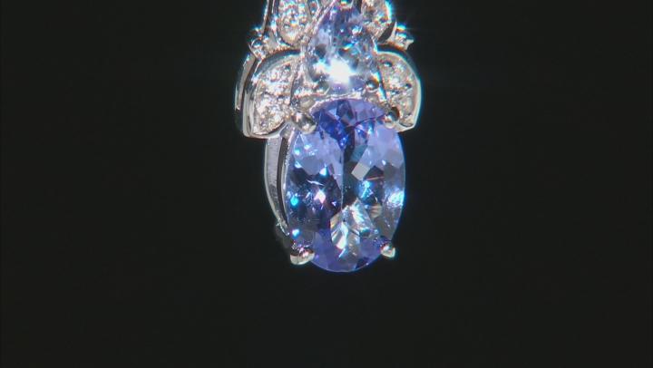 Blue tanzanite rhodium over silver pendant with  chain .81ctw